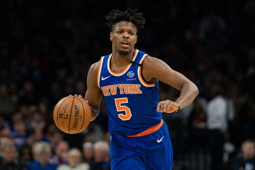 New York Knicks guard Dennis Smith Jr. (5) dribbles the ball against the Philadelphia 76ers during the second quarter at Wells Fargo Center.