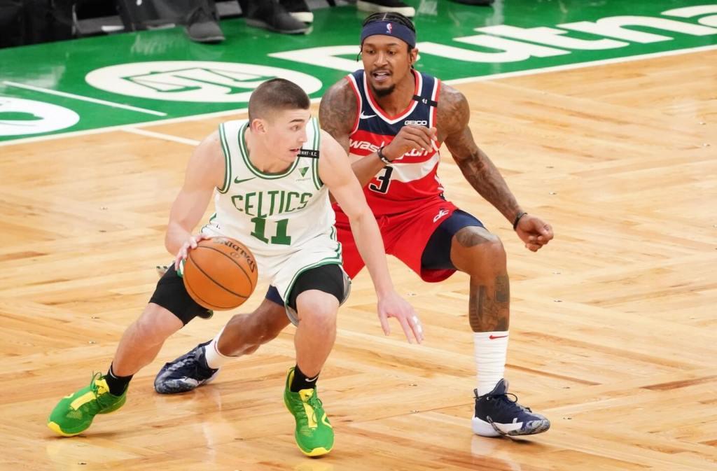 Washington Wizards guard Bradley Beal (3) defends against Boston Celtics guard Payton Pritchard (11) in the third quarter at TD Garden.