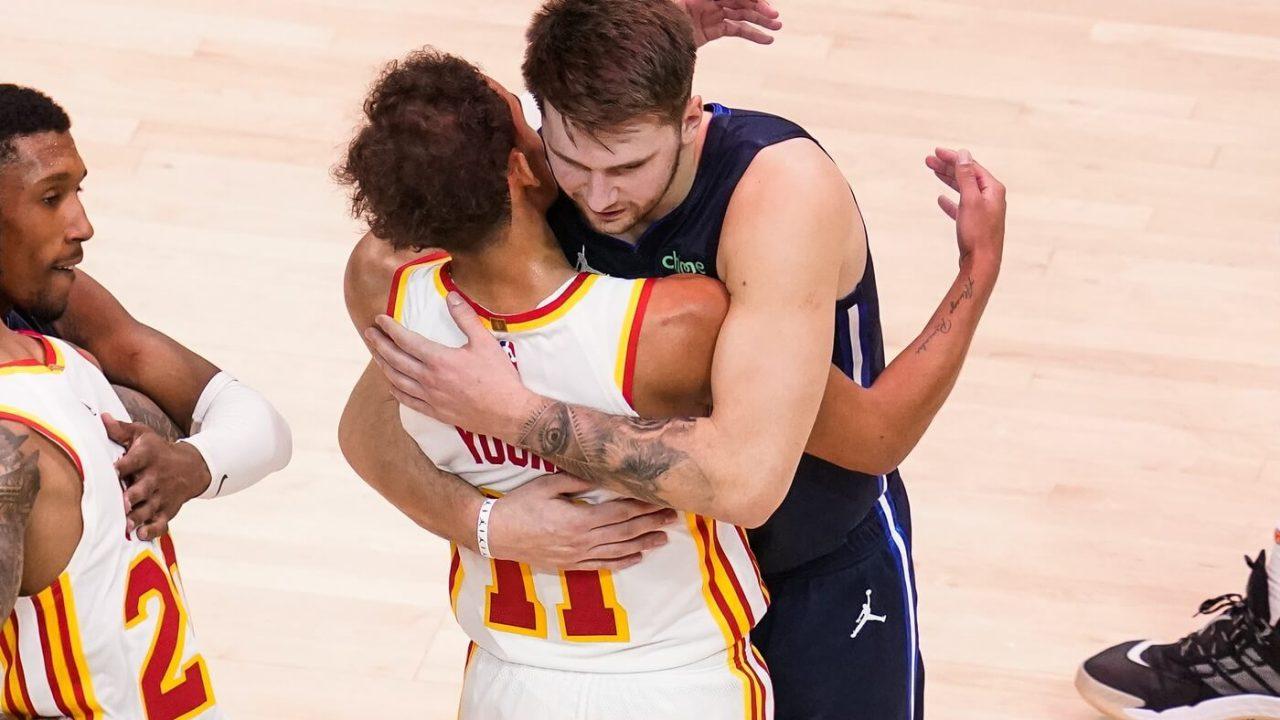 Feb 3, 2021; Atlanta, Georgia, USA; Dallas Mavericks guard Luka Doncic (77) and Atlanta Hawks guard Trae Young (11) react after the Mavericks defeated the Hawks at State Farm Arena.
