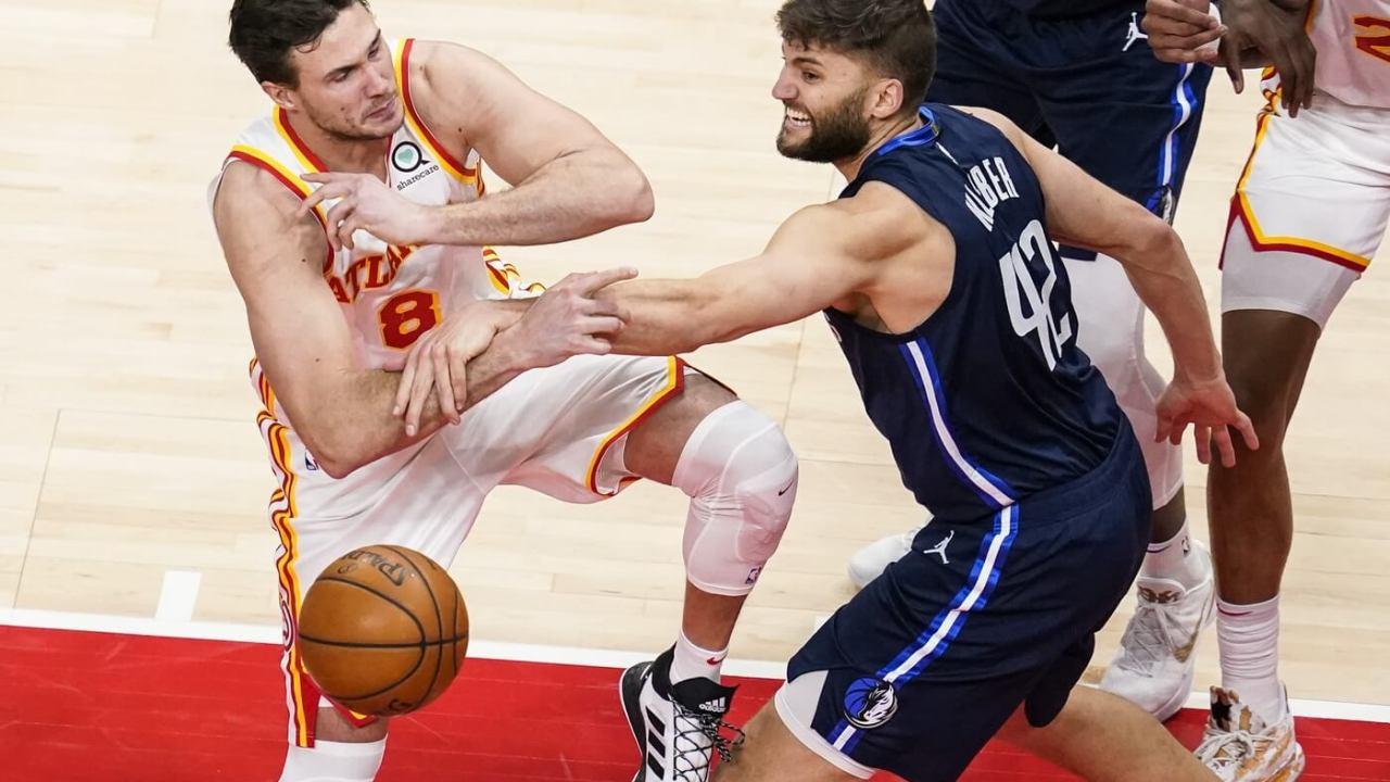 Dallas Mavericks forward Maxi Kleber (42) knocks the ball away from Atlanta Hawks forward Danilo Gallinari (8) during the second half at State Farm Arena.