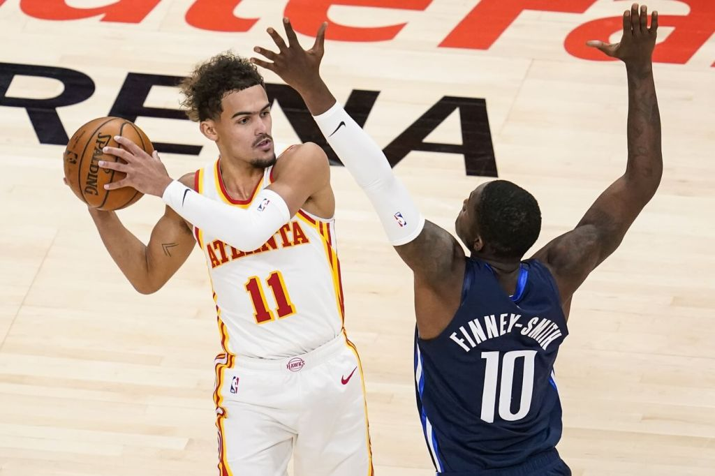 Atlanta Hawks guard Trae Young (11) looks for a pass against Dallas Mavericks forward Dorian Finney-Smith (10) during the second half at State Farm Arena.