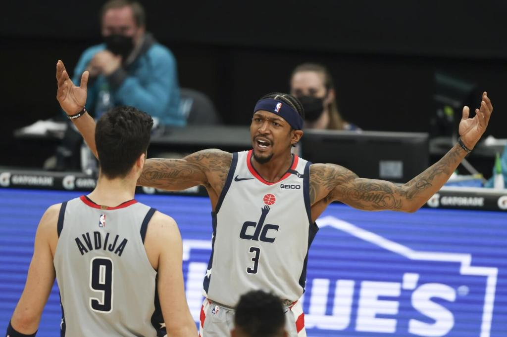 Feb 7, 2021; Charlotte, North Carolina, USA; Washington Wizards guard Bradley Beal (3) yells at forward Deni Avdija (9) as they play against the Charlotte Hornets in the first half at Spectrum Center. Mandatory Credit: Nell Redmond-USA TODAY Sports