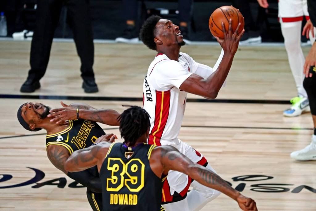 Oct 9, 2020; Lake Buena Vista, Florida, USA; Miami Heat forward Bam Adebayo (13) fouls Los Angeles Lakers guard Kentavious Caldwell-Pope (1) during the first quarter in game five of the 2020 NBA Finals at AdventHealth Arena. Mandatory Credit: Kim Klement-USA TODAY Sports