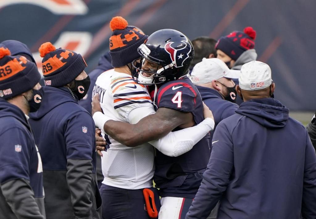 Dec 13, 2020; Chicago, Illinois, USA; Chicago Bears quarterback Mitchell Trubisky (10) and Houston Texans quarterback Deshaun Watson (4) embrace after the game at Soldier Field. Mandatory Credit: Mike Dinovo-USA TODAY Sports