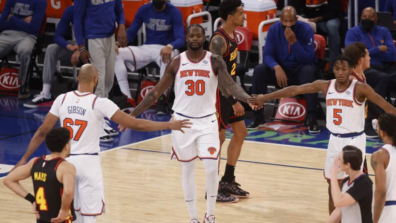 Feb 15, 2021; New York, New York, USA; New York Knicks' Julius Randle (30) is congratulated by teammates Taj Gibson (67) and Immanuel Quickley (5) during the third quarter at Madison Square Garden. Mandatory Credit: Jason DeCrow/Pool Photo-USA TODAY Sports
