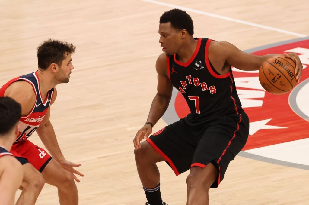Feb 10, 2021; Washington, District of Columbia, USA; Toronto Raptors guard Kyle Lowry (7) dribbles the ball as Washington Wizards guard Raul Neto (19) defends in the third quarter at Capital One Arena. Mandatory Credit: Geoff Burke-USA TODAY Sports