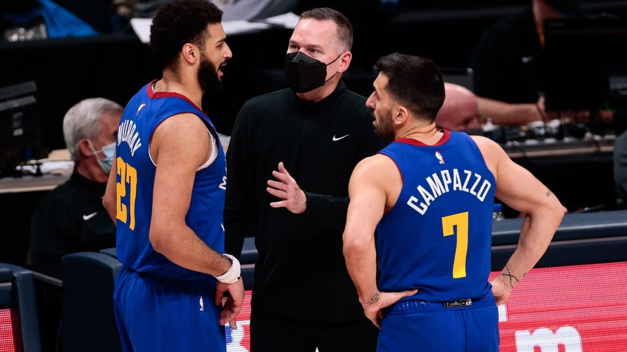 Feb 14, 2021; Denver, Colorado, USA; Denver Nuggets head coach Michael Malone talks with guard Jamal Murray (27) and guard Facundo Campazzo (7) in the fourth quarter against the Los Angeles Lakers at Ball Arena. Mandatory Credit: Isaiah J. Downing-USA TODAY Sports