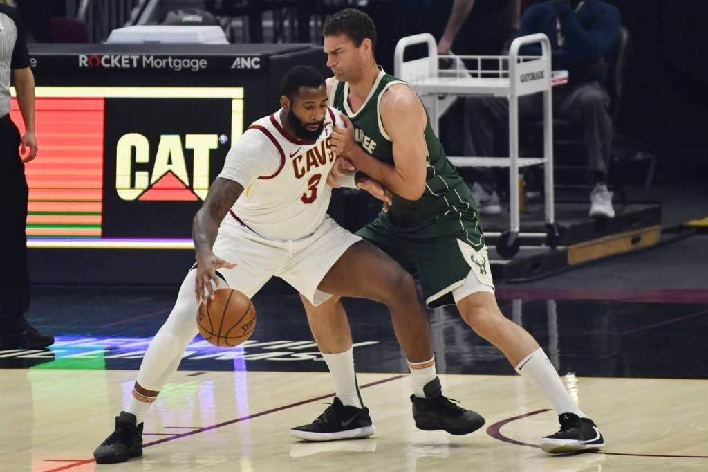Feb 6, 2021; Cleveland, Ohio, USA; Cleveland Cavaliers center Andre Drummond (3) works against Milwaukee Bucks center Brook Lopez (right) during the first quarter at Rocket Mortgage FieldHouse. Mandatory Credit: Ken Blaze-USA TODAY Sports