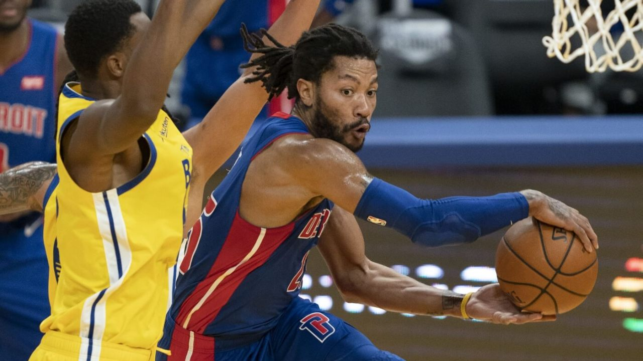 January 30, 2021; San Francisco, California, USA; Detroit Pistons guard Derrick Rose (25) passes the basketball against Golden State Warriors forward Andrew Wiggins (22) during the second quarter at Chase Center. Mandatory Credit: Kyle Terada-USA TODAY Sports