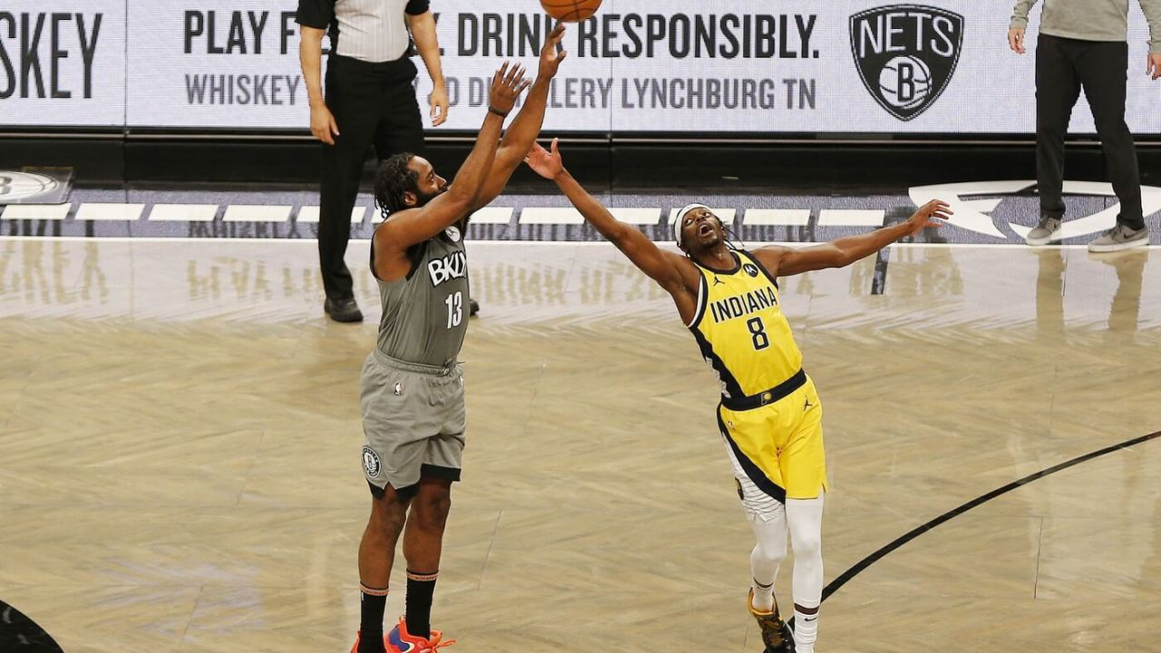Feb 10, 2021; Brooklyn, New York, USA; Brooklyn Nets guard James Harden (13) takes a shot against Indiana Pacers guard Justin Holiday (8) during the second half at Barclays Center. Mandatory Credit: Andy Marlin-USA TODAY Sports