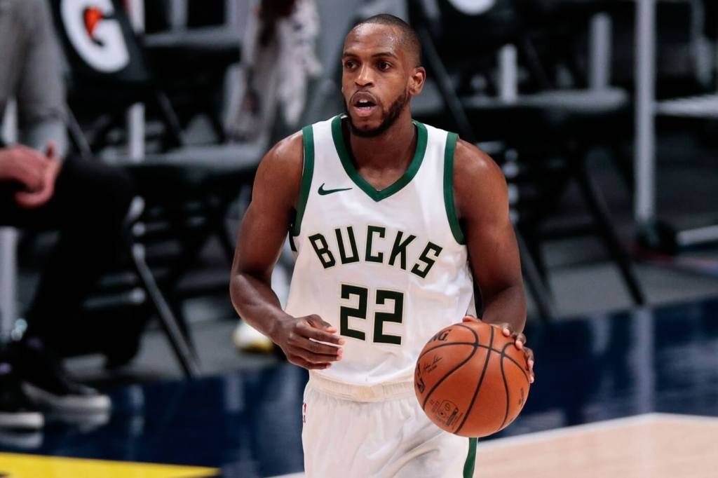Feb 8, 2021; Denver, Colorado, USA; Milwaukee Bucks forward Khris Middleton (22) dribbles the ball up court in the second quarter against the Denver Nuggets at Ball Arena. Mandatory Credit: Isaiah J. Downing-USA TODAY Sports