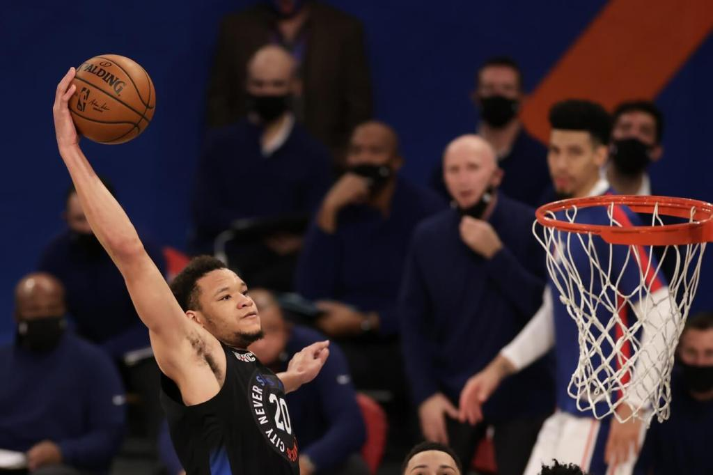 Dec 26, 2020; New York, New York, USA; New York Knicks forward Kevin Knox II slam dunks the ball during the second half of an NBA basketball game against the Philadelphia 76ers on Saturday, Dec. 26, 2020, in New York. The 76ers defeated the Knicks 109-89 at Madison Square Garden. Mandatory Credit: Adam Hunger/Pool Photo-USA TODAY Sports