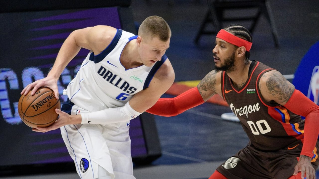 Feb 14, 2021; Dallas, Texas, USA; Portland Trail Blazers forward Carmelo Anthony (00) guards Dallas Mavericks center Kristaps Porzingis (6) during the second half at the American Airlines Center. Mandatory Credit: Jerome Miron-USA TODAY Sports