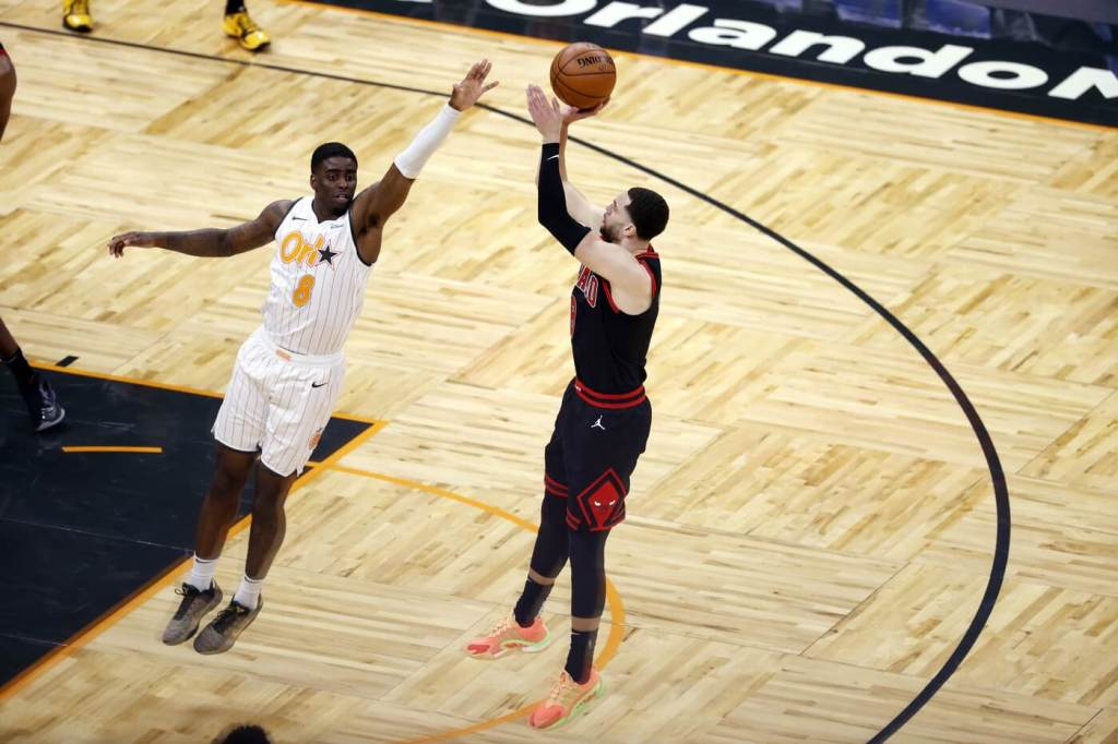 Feb 6, 2021; Orlando, Florida, USA; Chicago Bulls guard Zach LaVine (8) shoots over Orlando Magic forward Dwayne Bacon (8) during the second quarter at Amway Center. Mandatory Credit: Kim Klement-USA TODAY Sports