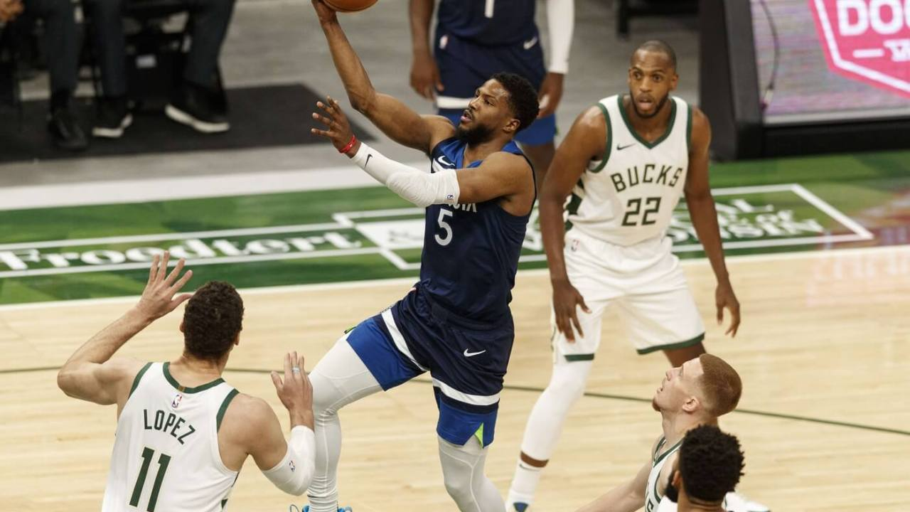 Feb 23, 2021; Milwaukee, Wisconsin, USA; Minnesota Timberwolves guard Malik Beasley (5) moves in for a basket during the first quarter against the Milwaukee Bucks at Fiserv Forum. Mandatory Credit: Jeff Hanisch-USA TODAY Sports