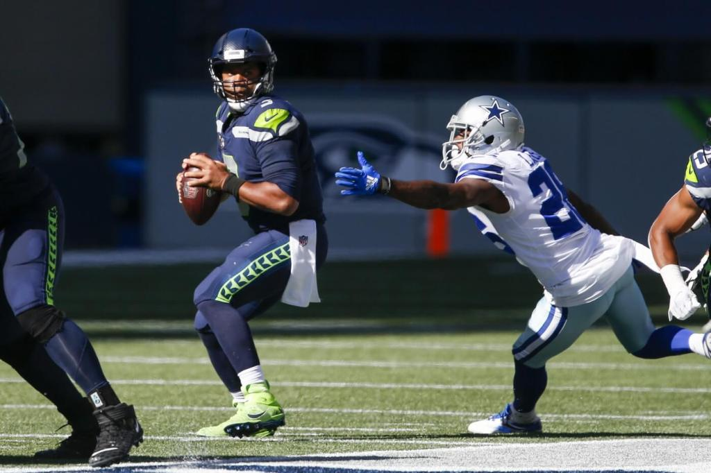 Sep 27, 2020; Seattle, Washington, USA; Seattle Seahawks quarterback Russell Wilson (3) looks to pass under pressure from Dallas Cowboys cornerback Jourdan Lewis (26) during the second quarter at CenturyLink Field. Mandatory Credit: Joe Nicholson-USA TODAY Sports