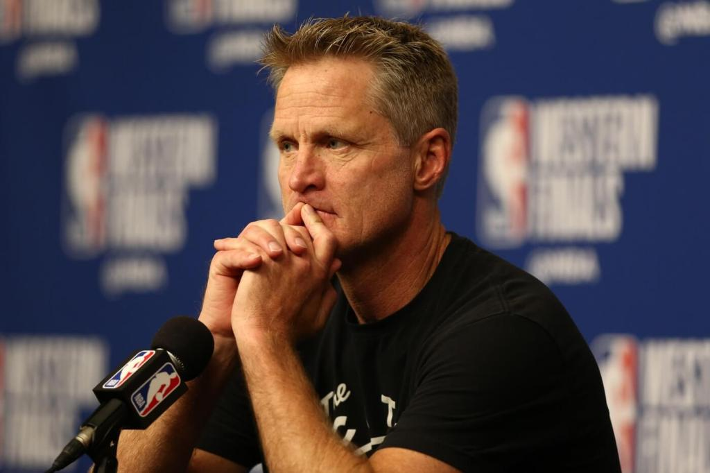 Golden State Warriors head coach Steve Kerr answers questions during a press conference before game one of the Western conference finals of the 2018 NBA Playoffs against the Houston Rockets at Toyota Center.