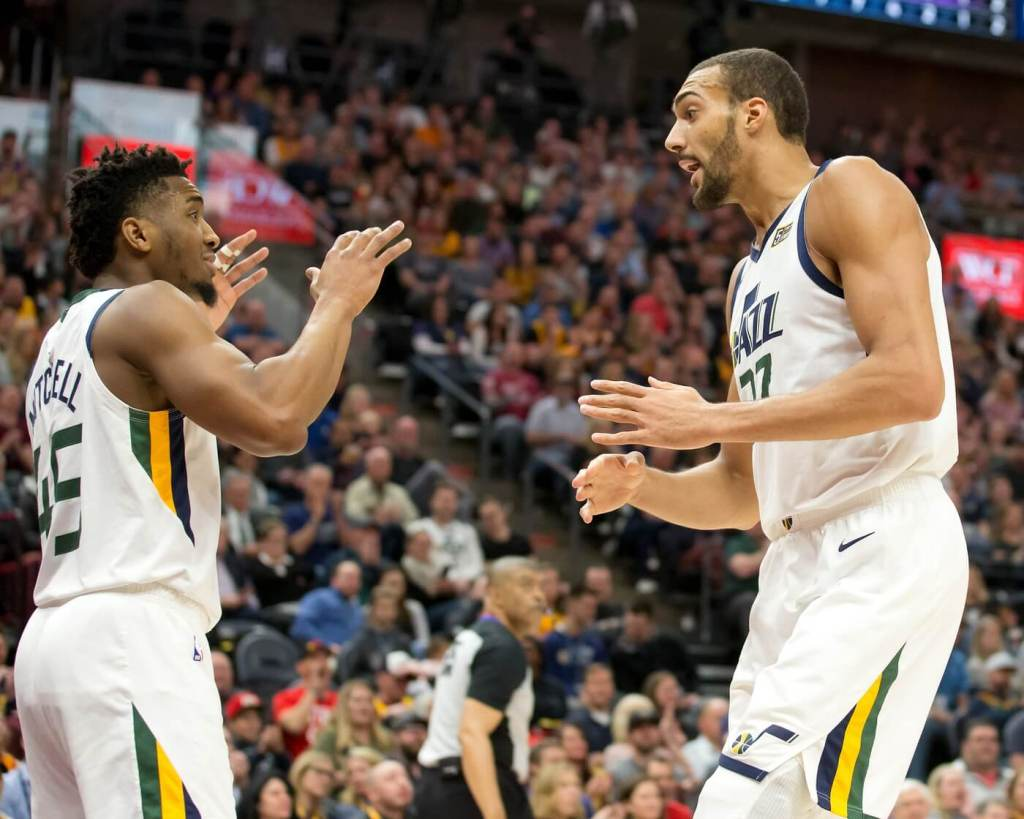 Utah Jazz center Rudy Gobert (27) and guard Donovan Mitchell (45) react during the first quarter against the Sacramento Kings at Vivint Smart Home Arena.
