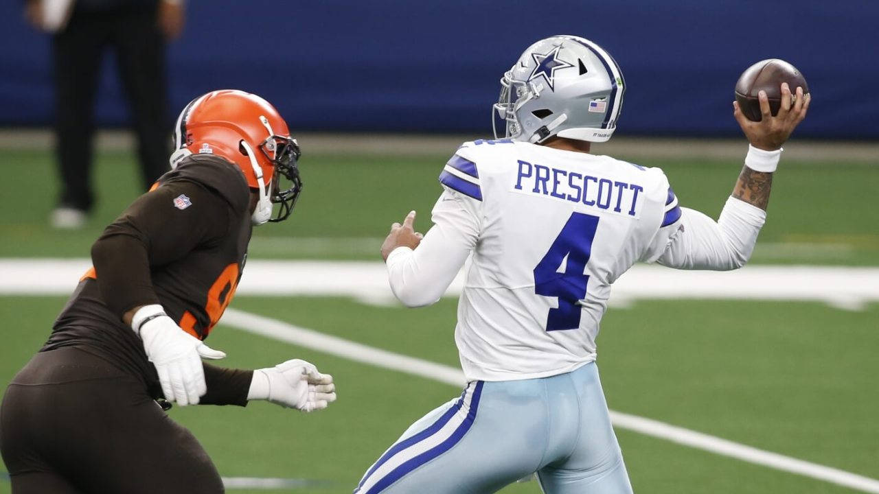Dallas Cowboys quarterback Dak Prescott (4) drops back to pass against Cleveland Browns defensive end Myles Garrett (95) in the first quarter at AT&T Stadium.