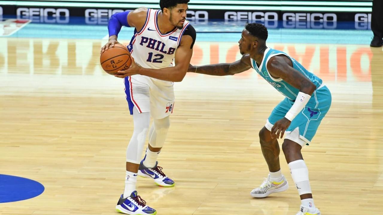 Jan 2, 2021; Philadelphia, Pennsylvania, USA; Philadelphia 76ers forward Tobias Harris (12) is guarded by Charlotte Hornets guard Terry Rozier (3) at Wells Fargo Center.
