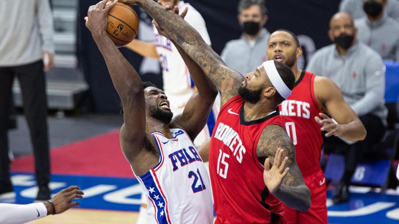 Feb 17, 2021; Philadelphia, Pennsylvania, USA; Houston Rockets center DeMarcus Cousins (15) blocks the shot attempt of Philadelphia 76ers center Joel Embiid (21) during the fourth quarter at Wells Fargo Center.
