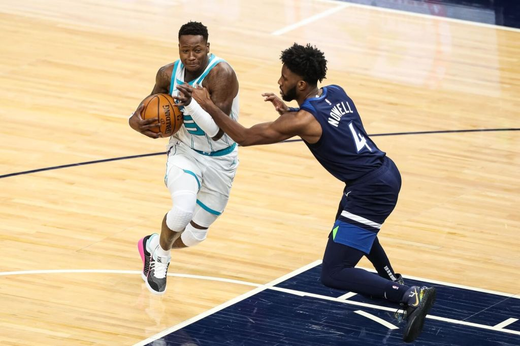Mar 3, 2021; Minneapolis, Minnesota, USA; Charlotte Hornets guard Terry Rozier (3) drives to the basket against Minnesota Timberwolves guard Jaylen Nowell (4) in the third quarter at Target Center. Mandatory Credit: David Berding-USA TODAY Sports