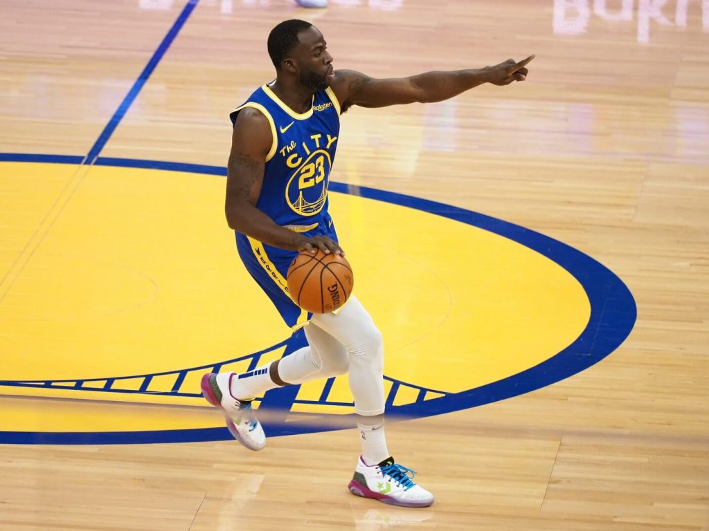 Golden State Warriors forward Draymond Green (23) calls out to teammates as he bring the ball down the court against the Utah Jazz during the first quarter at Chase Center.