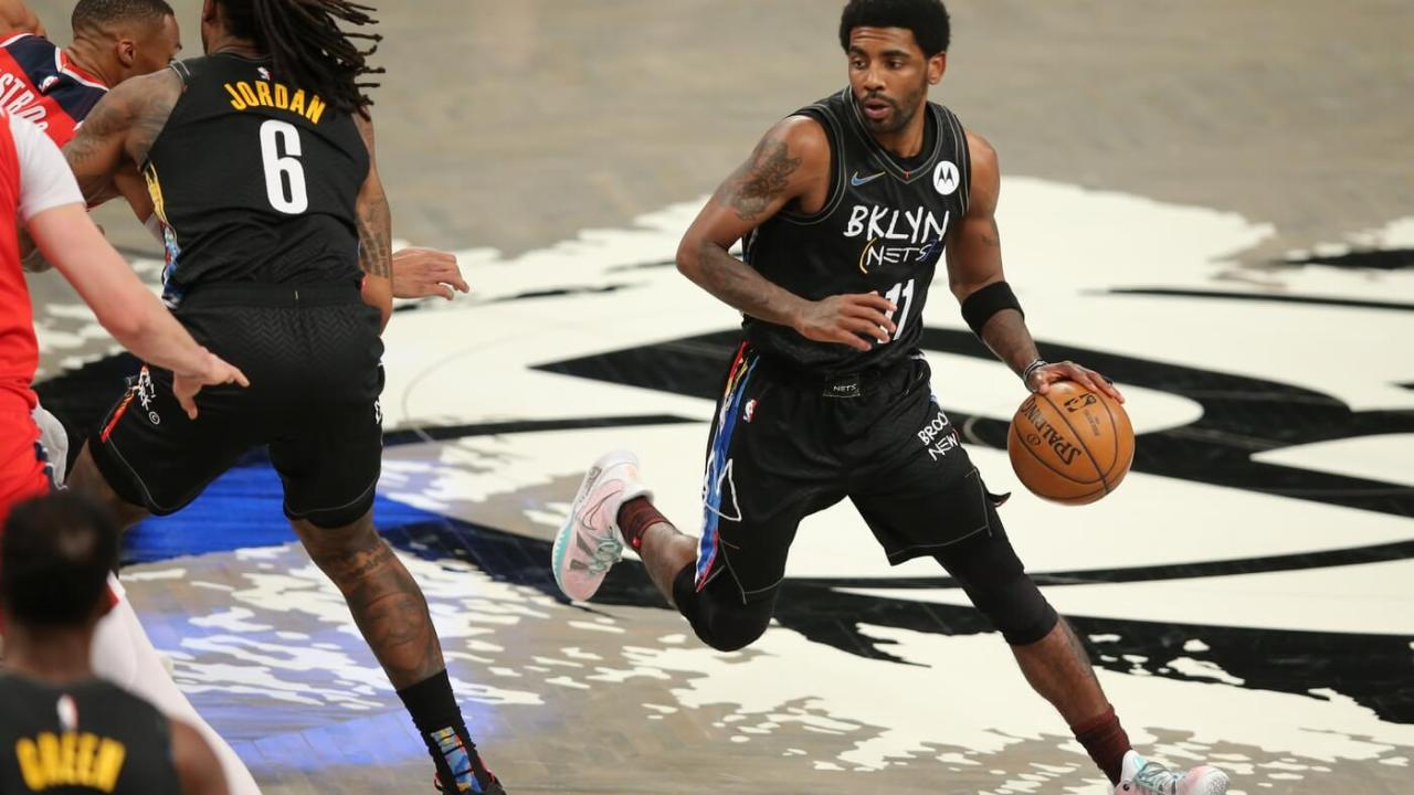 Mar 21, 2021; Brooklyn, New York, USA; Brooklyn Nets point guard Kyrie Irving (11) controls the ball against the Washington Wizards during the first quarter at Barclays Center.