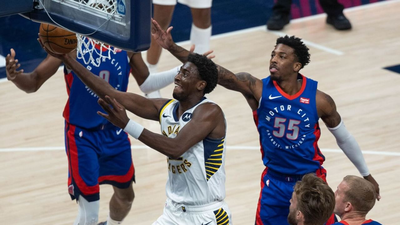 Mar 24, 2021; Indianapolis, Indiana, USA; Indiana Pacers guard Caris LeVert (22) shoots the ball while Detroit Pistons guard Delon Wright (55) defends in the second quarter at Bankers Life Fieldhouse. Mandatory Credit: Trevor Ruszkowski-USA TODAY Sports