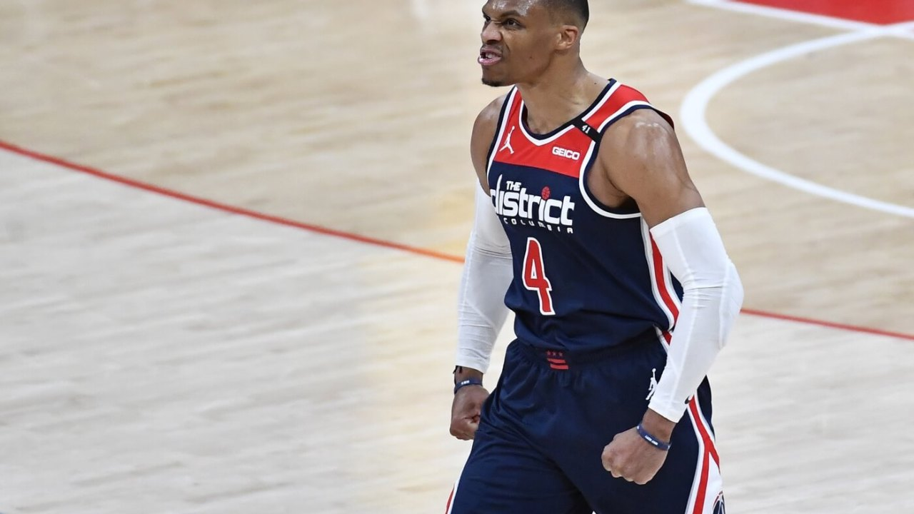 Mar 29, 2021; Washington, District of Columbia, USA; Washington Wizards guard Russell Westbrook (4) reacts after a three point basket against the Indiana Pacers during the fourth quarter at Capital One Arena.