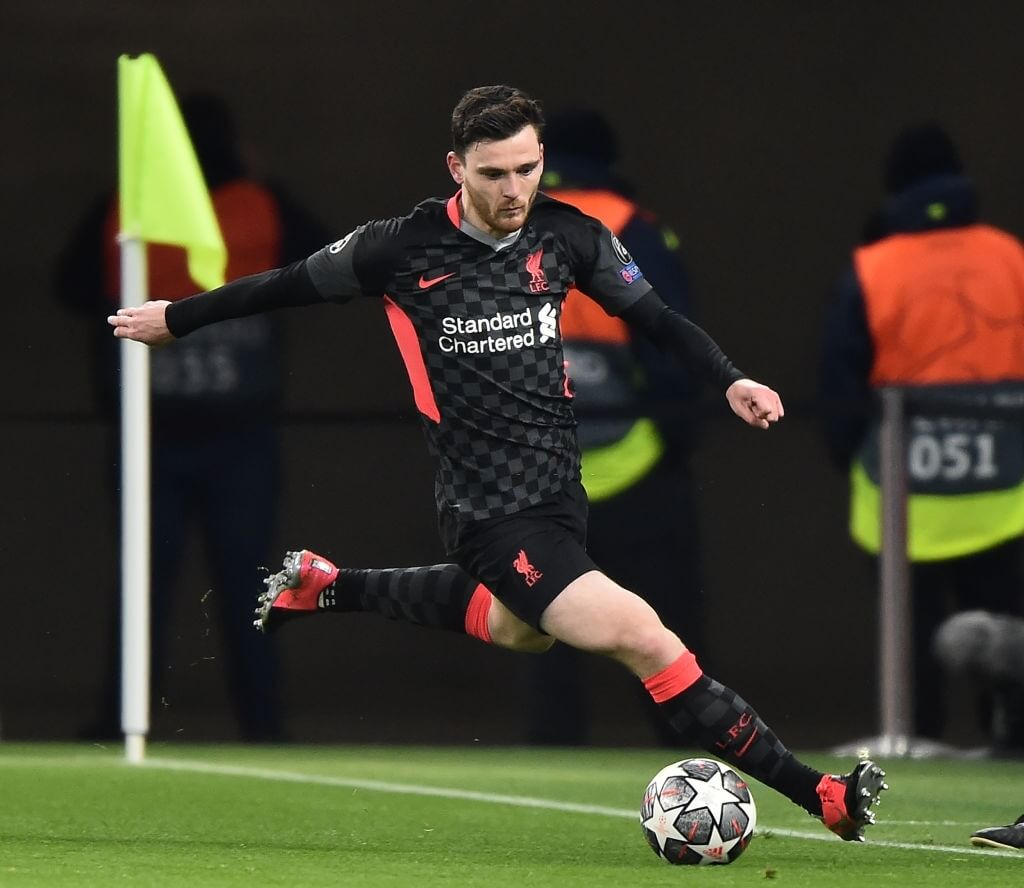 Liverpool's Scottish defender Andrew Robertson plays the ball during UEFA Champions League round of 16, first leg football match between RB Leipzig and FC Liverpool in Puskas Arena of Budapest on February 16, 2021. (Photo by ATTILA KISBENEDEK / AFP) (Photo by ATTILA KISBENEDEK/AFP via Getty Images)