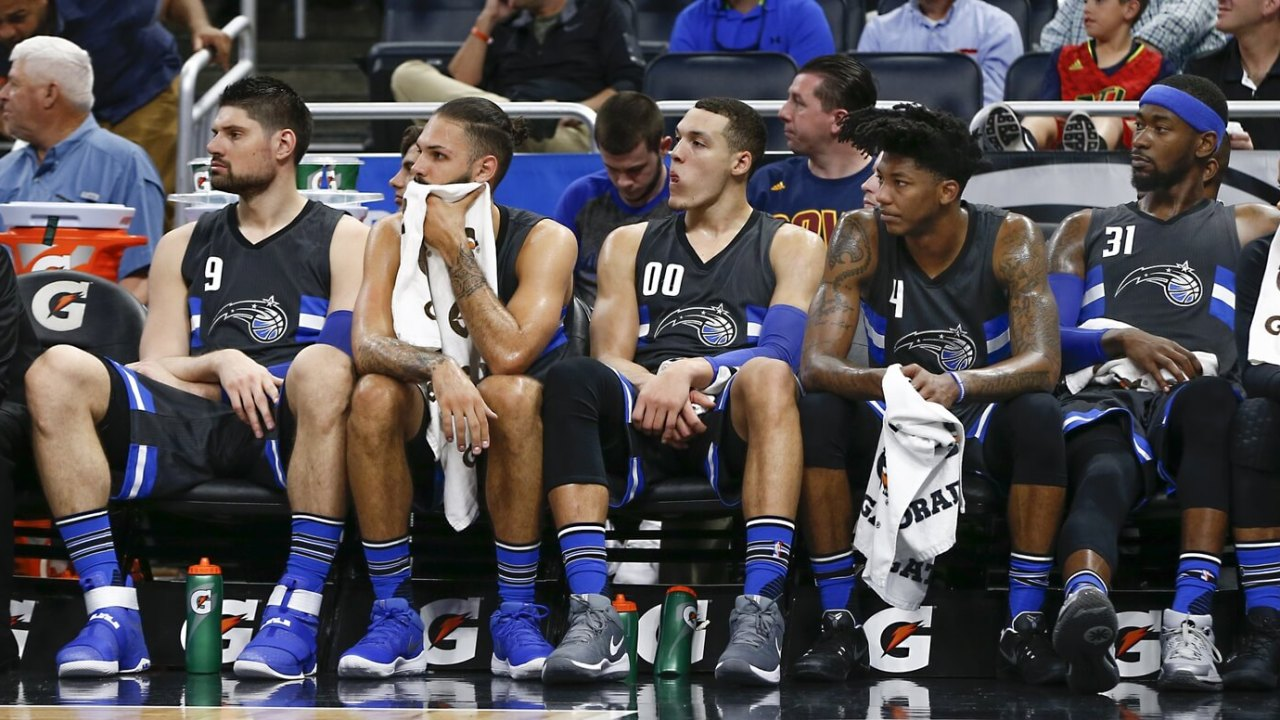 Mar 11, 2017; Orlando, FL, USA; With less than a minute left in the game key magic players watch the game from the bench (left to right) Orlando Magic center Nikola Vucevic (9) and guard Evan Fournier (10) and forward Aaron Gordon (00) and guard Elfrid Payton (4) and forward Terrence Ross (31) during the second half of an NBA basketball game at Amway Center. The Cavaliers won 116-104.