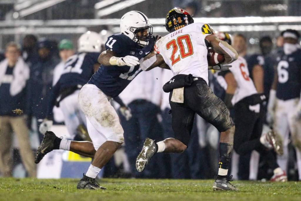 Nov 24, 2018; University Park, PA, USA; Penn State Nittany Lions linebacker Micah Parsons (11) attempts to tackle Maryland Terrapins running back Javon Leake (20) during the fourth quarter at Beaver Stadium. Penn State defeated Maryland 38-3. Mandatory Credit: Matthew O'Haren-USA TODAY Sports