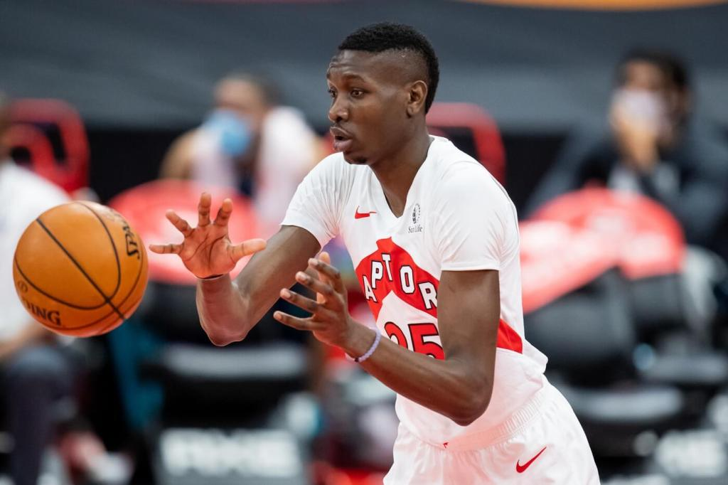 Jan 14, 2021; Tampa, Florida, USA; Toronto Raptors forward Chris Boucher (25) catches a pass during the second quarter of a game against the Charlotte Hornets at Amalie Arena. Mandatory Credit: Mary Holt-USA TODAY Sports