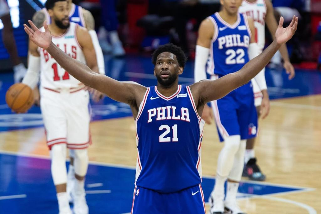Feb 19, 2021; Philadelphia, Pennsylvania, USA; Philadelphia 76ers center Joel Embiid (21) reacts after a score against the Chicago Bulls during the fourth quarter at Wells Fargo Center. Mandatory Credit: Bill Streicher-USA TODAY Sports