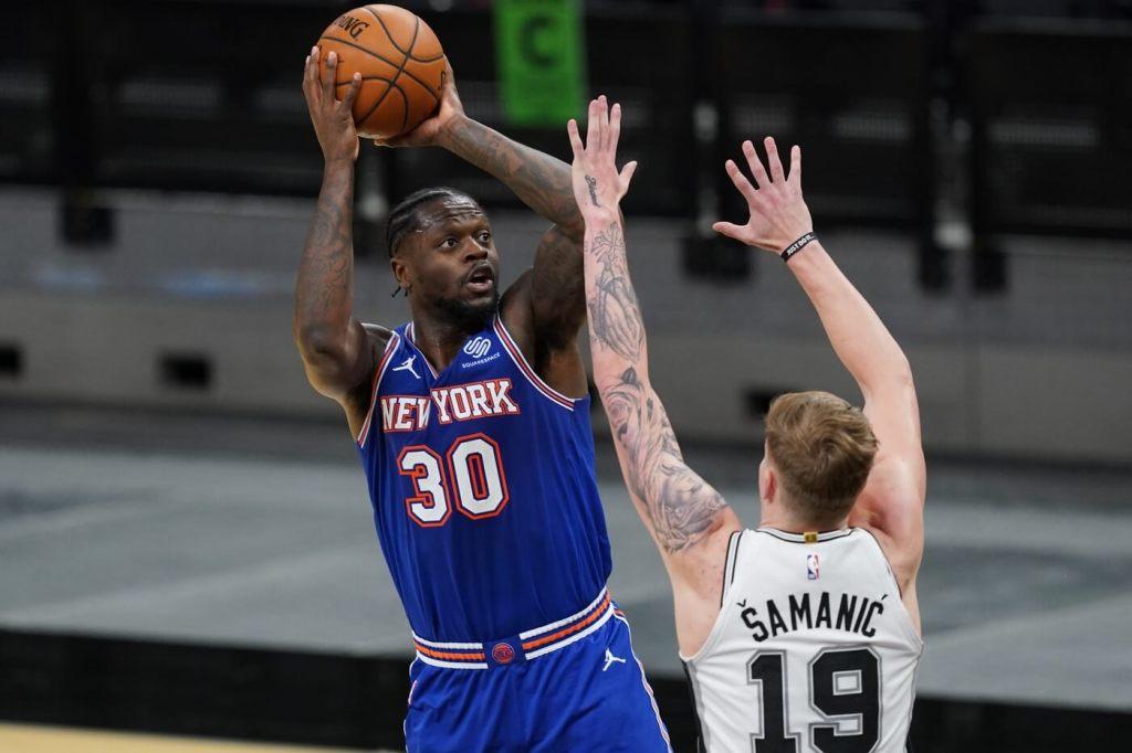 Mar 2, 2021; San Antonio, Texas, USA; New York Knicks forward Julius Randle (30) shoots over San Antonio Spurs forward Luka Samanic (19) in the second half at the AT&T Center. Mandatory Credit: Daniel Dunn-USA TODAY Sports
