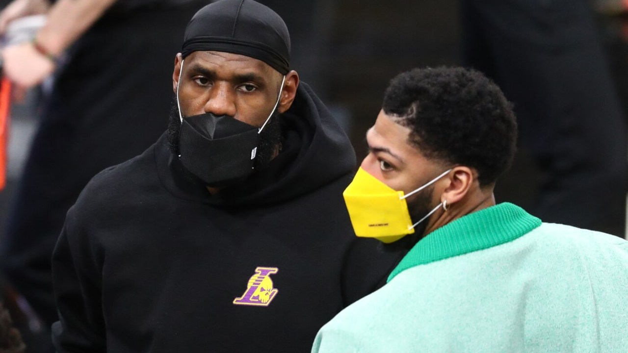 Mar 21, 2021; Phoenix, Arizona, USA; Los Angeles Lakers injured forward LeBron James (left) and Anthony Davis against the Phoenix Suns during the first half at Phoenix Suns Arena. Mandatory Credit: Mark J. Rebilas-USA TODAY Sports