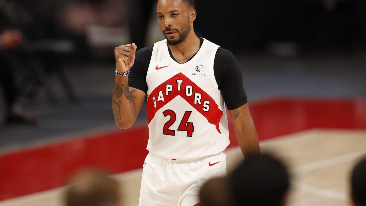 Mar 17, 2021; Detroit, Michigan, USA; Toronto Raptors guard Norman Powell (24) pumps his fist after the second quarter against the Detroit Pistons at Little Caesars Arena. Mandatory Credit: Raj Mehta-USA TODAY Sports