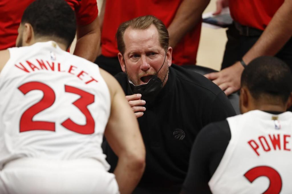 Mar 17, 2021; Detroit, Michigan, USA; Toronto Raptors head coach Nick Nurse talks to his team in a huddle during the fourth quarter against the Detroit Pistons at Little Caesars Arena. Mandatory Credit: Raj Mehta-USA TODAY Sports