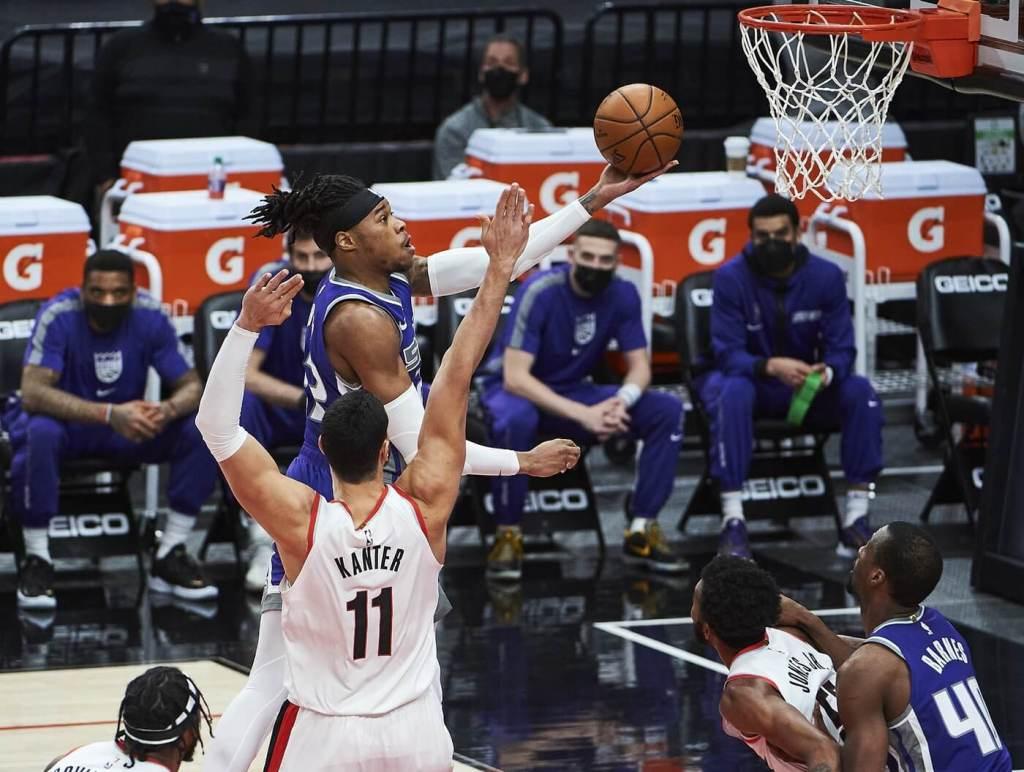 Mar 4, 2021; Portland, Oregon, USA; Sacramento Kings center Richaun Holmes (22) scores a basket against Portland Trail Blazers center Enes Kanter (11) during the first half at Moda Center. Mandatory Credit: Troy Wayrynen-USA TODAY Sports