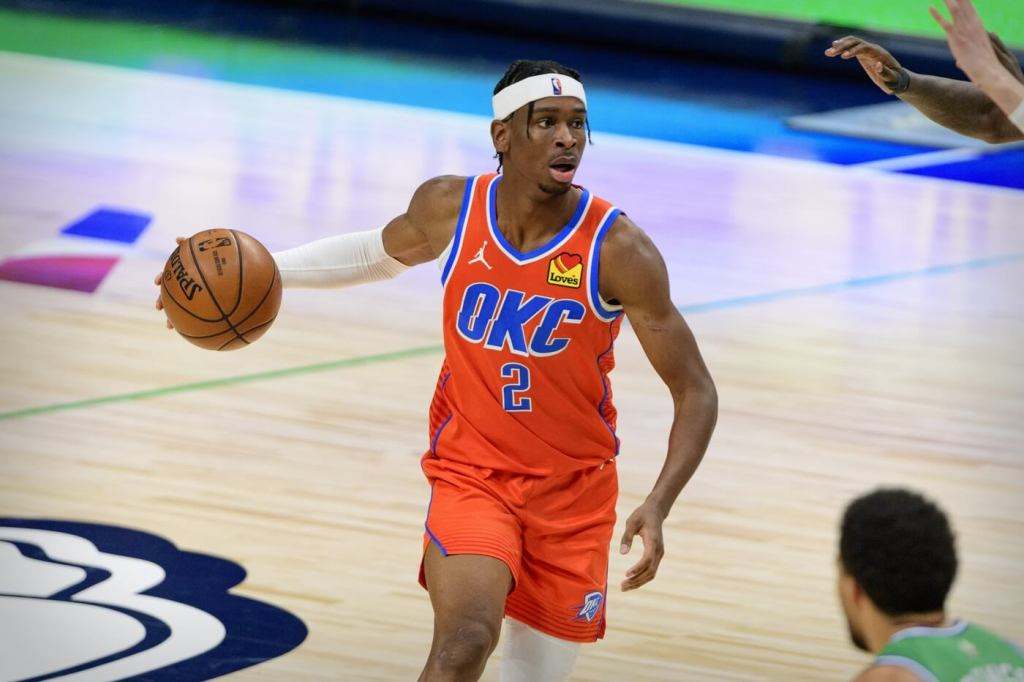 Mar 3, 2021; Dallas, Texas, USA; Oklahoma City Thunder guard Shai Gilgeous-Alexander (2) in action during the game between the Dallas Mavericks and the Oklahoma City Thunder at the American Airlines Center. Mandatory Credit: Jerome Miron-USA TODAY Sports