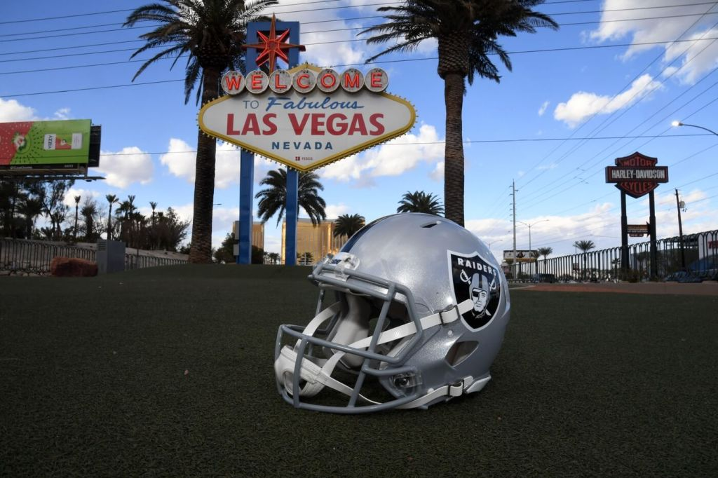 Dec 17, 2020; Paradise, Nevada, USA; A general view of a Las Vegas Raiders helmet at the Welcome to Fabulous Las Vegas sign on the Las Vegas strip. Mandatory Credit: Kirby Lee-USA TODAY Sports