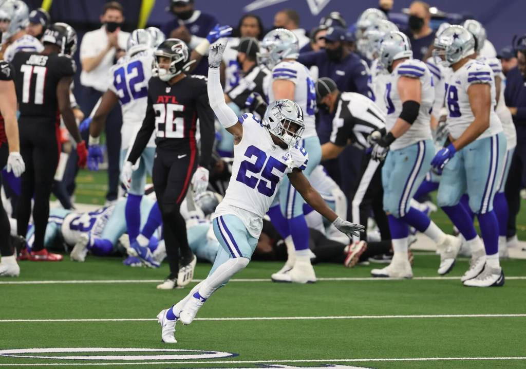 Sep 20, 2020; Arlington, Texas, USA; Dallas Cowboys cornerback safety Xavier Woods (25) celebrates after they recovered an on-side kick in the fourth quarter against the Atlanta Falcons at AT&T Stadium. Mandatory Credit: Matthew Emmons-USA TODAY Sports
