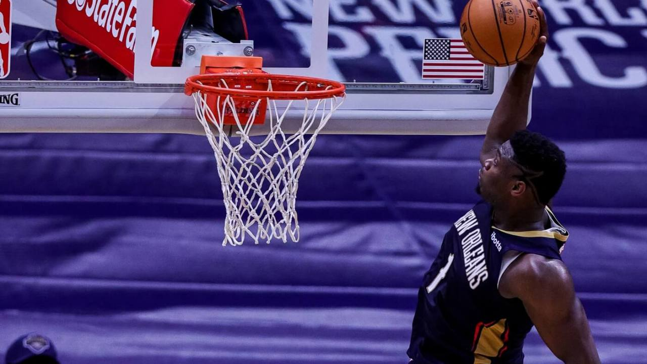 Feb 3, 2021; New Orleans, Louisiana, USA; New Orleans Pelicans forward Zion Williamson (1) dunks the ball over Phoenix Suns guard Chris Paul (3) during the second half at Smoothie King Center. Mandatory Credit: Stephen Lew-USA TODAY Sports