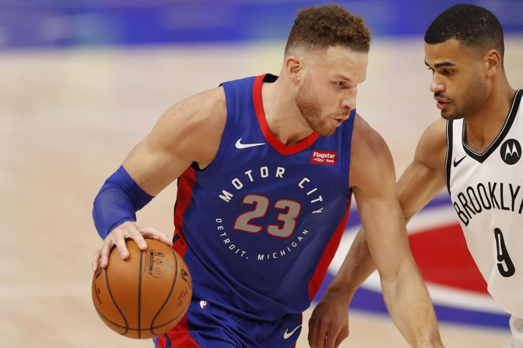 Feb 9, 2021; Detroit, Michigan, USA; Detroit Pistons forward Blake Griffin (23) dribbles the ball while defended by Brooklyn Nets guard Timothe Luwawu-Cabarrot (9) during the fourth quarter at Little Caesars Arena. Mandatory Credit: Raj Mehta-USA TODAY Sports
