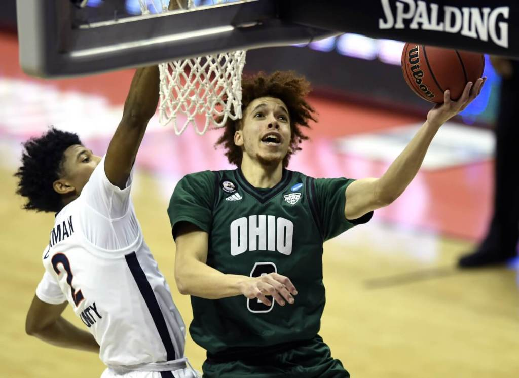 Ohio Bobcats guard Jason Preston (0) makes a shot over Virginia Cavaliers guard Reece Beekman (2) during the first round of the 2021 NCAA Tournament on Saturday, March 20, 2021, at Simon Skjodt Assembly Hall in Bloomington, Ind. Mandatory Credit: Sam Owens/Indy Star/IndyStar via USA TODAY Sports