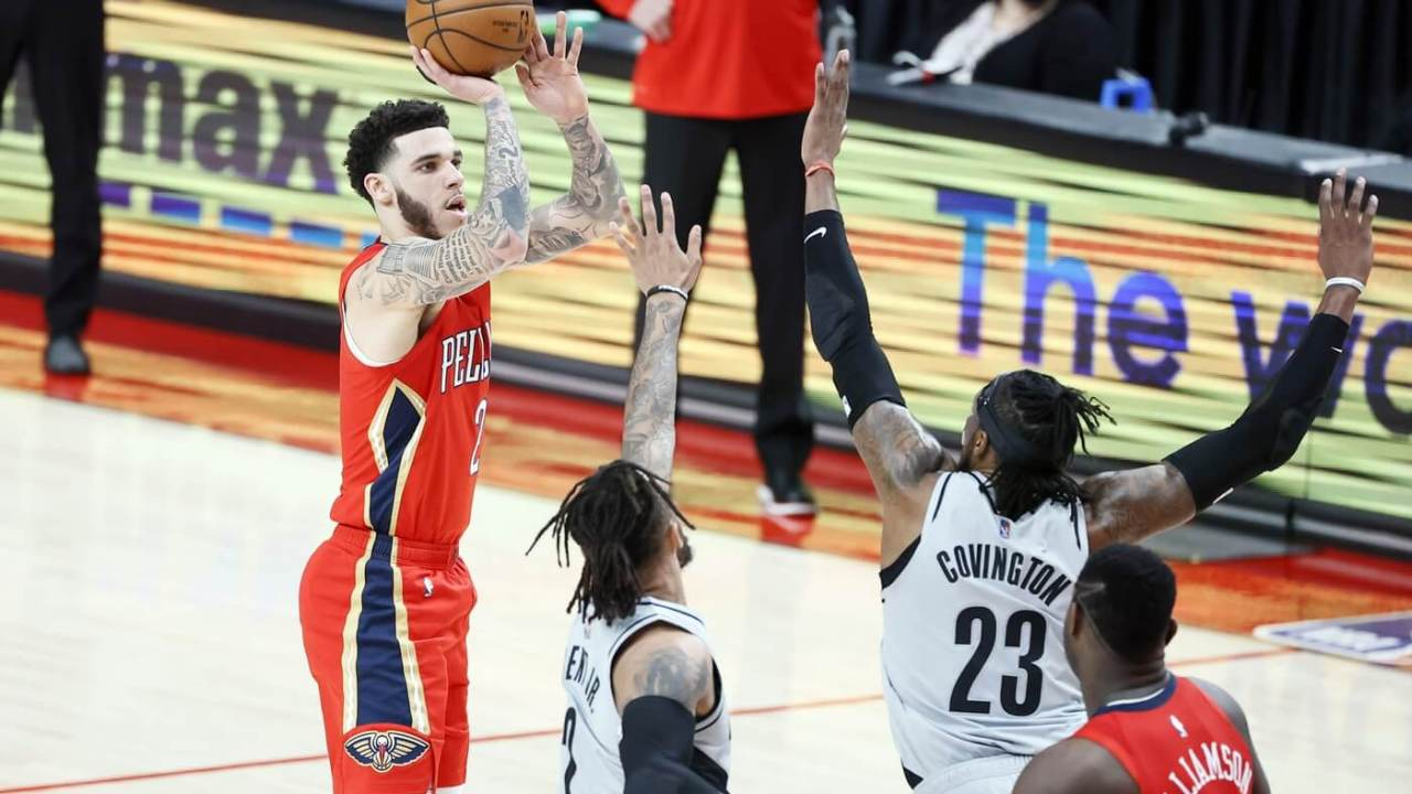 Mar 16, 2021; Portland, Oregon, USA; New Orleans Pelicans point guard Lonzo Ball (2) shoots the ball over Portland Trail Blazers power forward Robert Covington (23) during the first half at Moda Center. Mandatory Credit: Soobum Im-USA TODAY Sports
