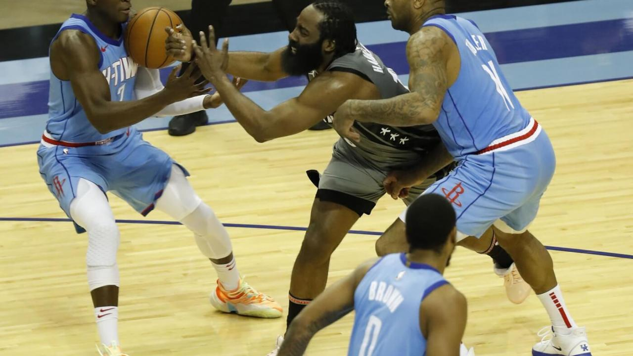 Mar 3, 2021; Houston, Texas, USA; James Harden #13 of the Brooklyn Nets loses the ball as he is pressured by P.J. Tucker #17 of the Houston Rockets and Victor Oladipo #7 during the second quarter at Toyota Center on March 03, 2021 in Houston, Texas. Mandatory Credit: Bob Levey-POOL PHOTOS-USA TODAY Sports