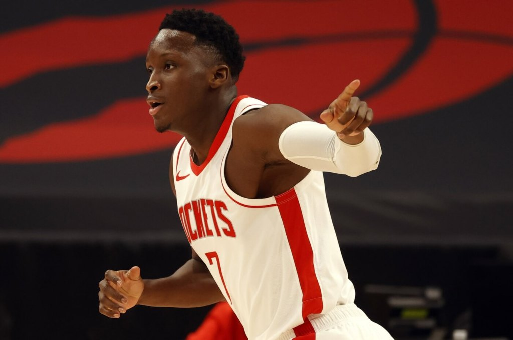 Feb 26, 2021; Tampa, Florida, USA; Houston Rockets guard Victor Oladipo (7) point as he makes a three point basket against the Toronto Raptors during the first half at Amalie Arena. Mandatory Credit: Kim Klement-USA TODAY Sports