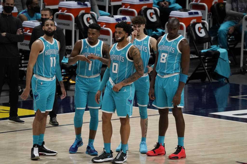 Mar 17, 2021; Denver, Colorado, USA; Charlotte Hornets forward Cody Martin (11) and guard Malik Monk (1) and forward Miles Bridges (0) and guard LaMelo Ball (2) and center Bismack Biyombo (8) look on during the second half against the Denver Nuggets at Ball Arena. Mandatory Credit: Ron Chenoy-USA TODAY Sports